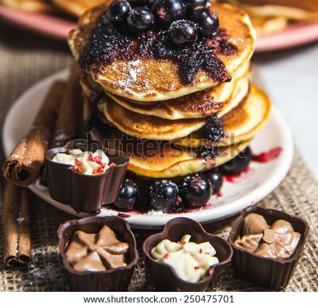 Pancakes with currant jam and cinnamon ikrasheny sides and sweets - stock photo