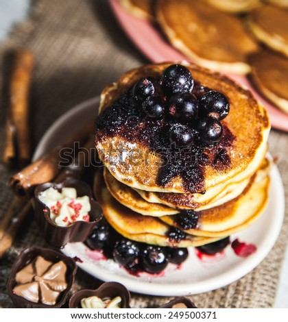 Pancakes with currant jam and cinnamon ikrasheny sides and sweets. Delicious food. dessert - stock photo