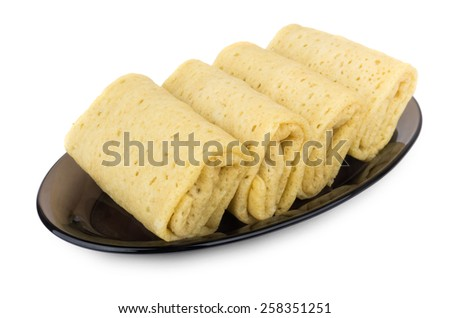 Pancakes with filling in dish isolated on white background