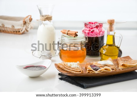 pancakes with filling on a white background - stock photo