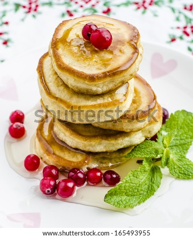 Pancakes with honey and cranberries for breakfast on Valentine's Day