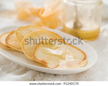 Pancakes with honey, selective focus