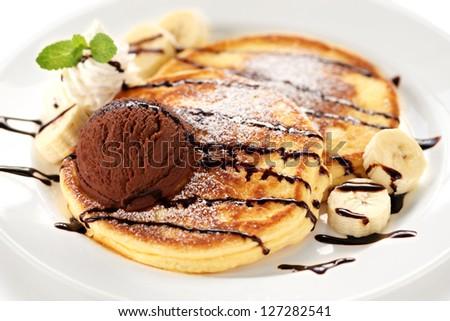 pancakes with ice cream and chocolate sauce - stock photo