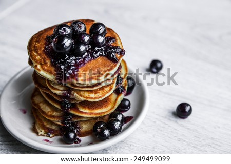 Pancakes with jam and currants. Delicious food. dessert - stock photo