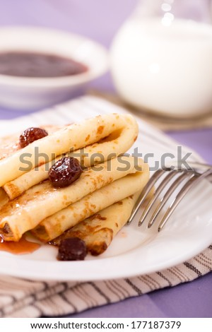 Pancakes with jam and milk