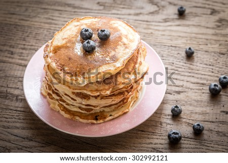 Pancakes with maple syrup and fresh berries - stock photo