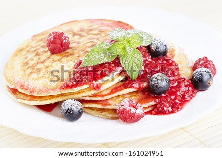 Pancakes with raspberry jam - stock photo