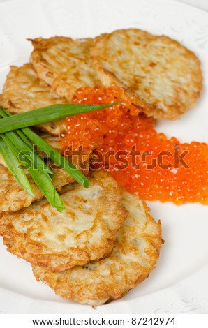pancakes with red caviar and green onion closeup dish