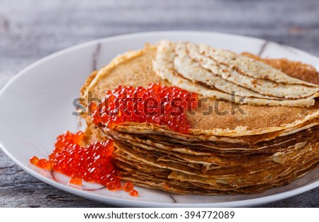Pancakes with red caviar.Carnival.selective focus.
