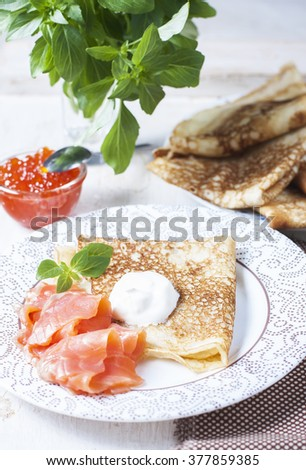 Pancakes with salmon caviar,  traditional Russian meal. Selective focus