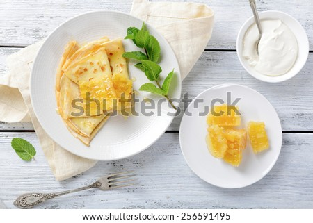 Pancakes with sour cream and mint. Top view - stock photo