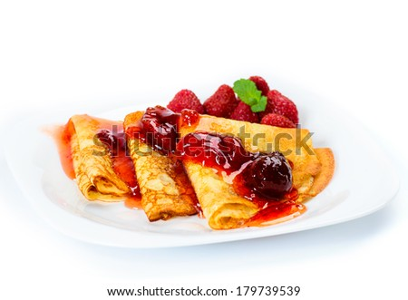 Pancakes with strawberry jam. - stock photo