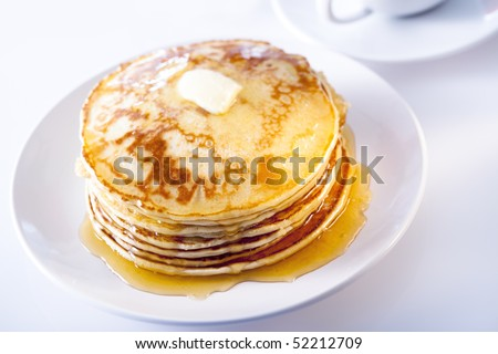 pancakes with syrup and butter - stock photo