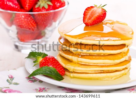 Pancakes with syrup and strawberry