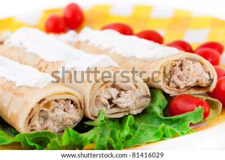 Pancakes with the chicken, lettuce, and tomatoes on the yellow plate - stock photo