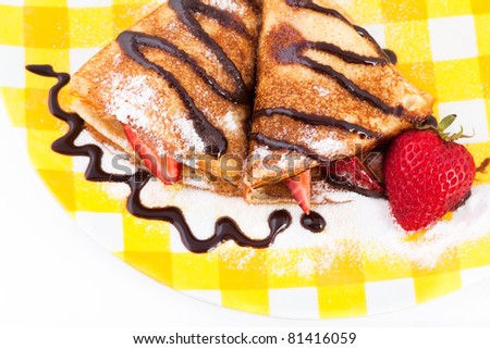 Pancakes with the strawberries on a plate, top-view - stock photo