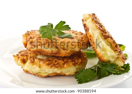 pancakes with vegetable greens on a white background - stock photo