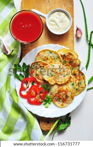 Pancakes with vegetables, sour sauce and tomato juice
