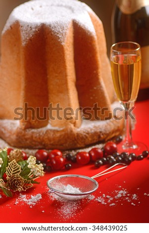 Pandoro on the table red - the traditional Italian Christmas cake