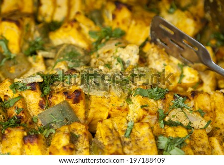 Paneer Tikka. Homemade cheese with spices cooked in tandoor - stock photo