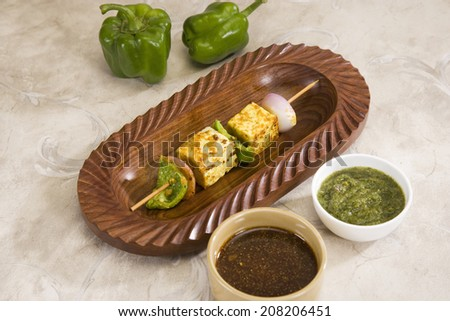 Paneer Tikka Kebab - Tandoori Indian cheese skewers with chili sauce - stock photo