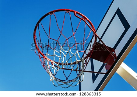 Panel basketball hoop under a blue sky