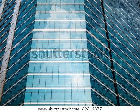 Panel glass windows of modern buildings and sky reflect - stock photo