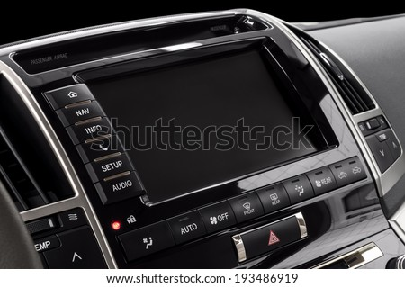 Panel of a modern car. Screen multimedia system. - stock photo