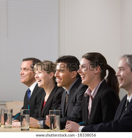 Panel of co-workers laughing - stock photo