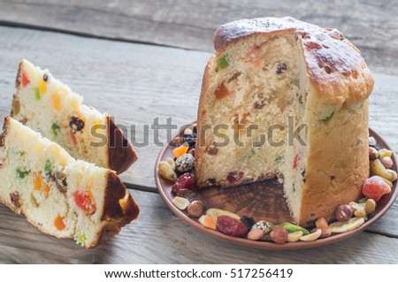Panettone with dried fruits on the wooden background