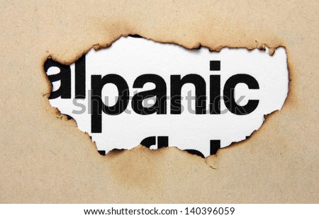 Panic text on paper hole - stock photo