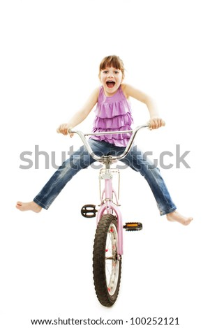 Panicked little girl losing control over her riding bike. Isolated on white background. - stock photo