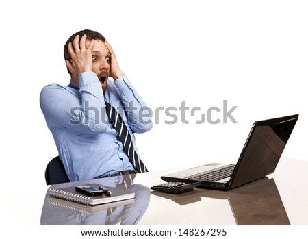 panicking businessman in horror looking at the laptop screen - isolated on white background / shocked businessman in panic looking at a laptop screen - isolated on white background  - stock photo