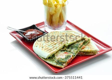 Panini spinach and ham   - stock photo