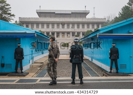 PANMUNJEON, SOUTH KOREA - APRIL 9: South Korean soldiers stand guard at the Demilitarized Zone on the North Korean border on April 9, 2016 in Panmunjeon, South Korea.