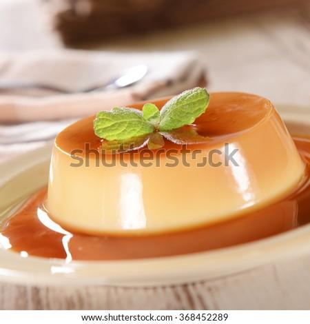 Panna cotta dessert with caramel sauce - stock photo