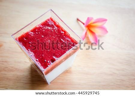 Panna cotta dessert with strawberry sirup. - stock photo