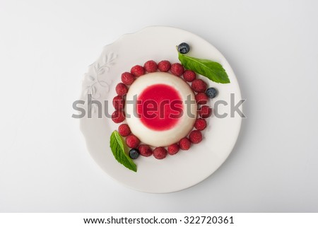 Panna cotta with berries and mint  top view - stock photo