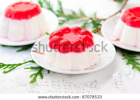 Panna cotta with fruit jelly for Christmas - stock photo