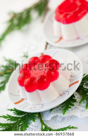 Panna cotta with fruit jelly for Christmas. Soft focus - stock photo