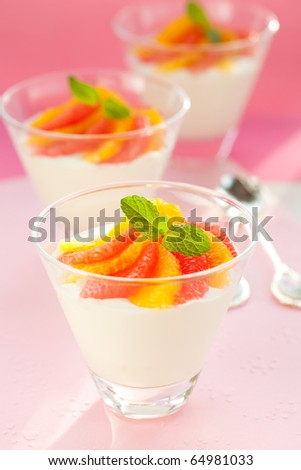 Panna cotta with orange and grapefruit in glasses - stock photo