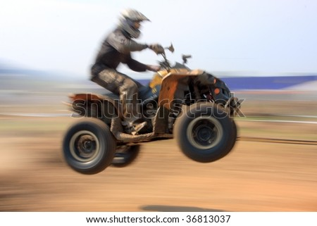 panned image of a motorbiker in the air
