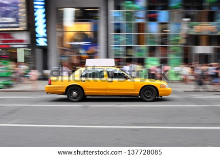 Panning shot of a NYC Taxi Cab at Times Square, New York. - stock photo