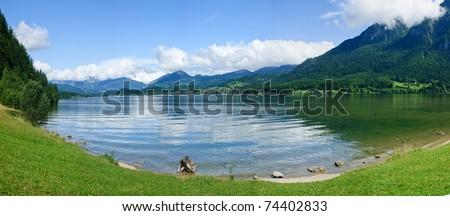 Panorama a transparent alpine lake. Salzkammergut. - stock photo
