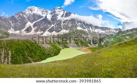 Panorama. Alpine lake in the northern Caucasus. - stock photo