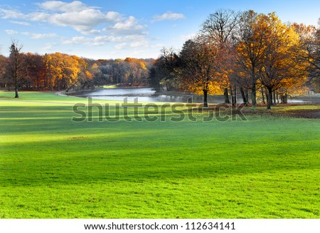 Panorama. Autumn Landscape. Park in Autumn. The bright colors of autumn in the park by the lake. - stock photo
