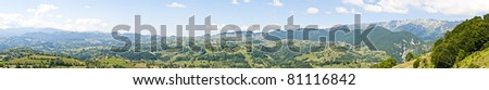 Panorama background in Carpathians. Beautiful mountains and landscape in Romania. - stock photo