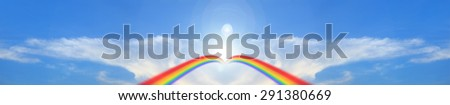 Panorama blue sky clouds.Beautiful rainbow in the sky.Wing cloud on blue sky.  - stock photo