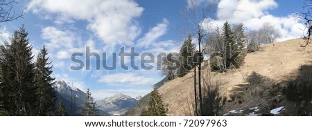 Panorama, Blue sky day in the winter, trees and pastures, French Alps