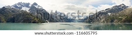 Panorama for the Johns Hopkins Glacier in Glacier Bay National Park taken from a cruise ship - stock photo